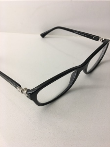 A pair of eyeglasses on the countertop